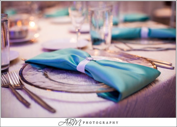 Blue uplights added pops of color along with the tiffany blue napkins