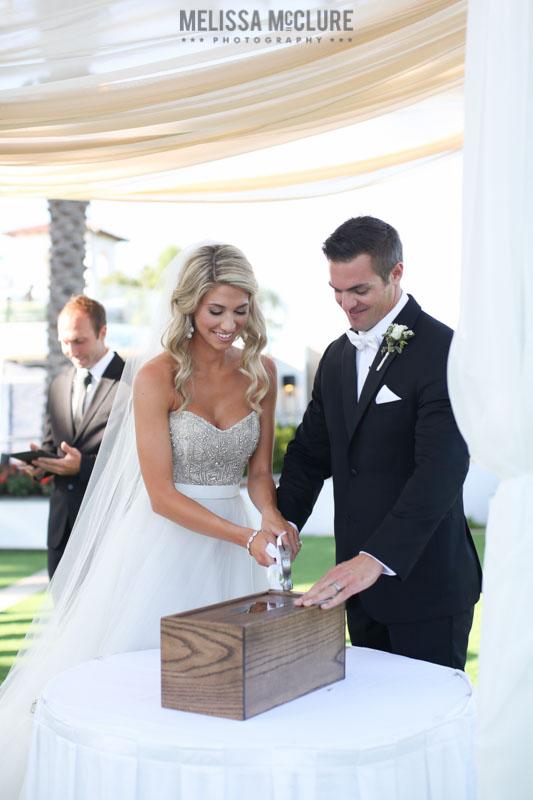 Nailing the wine box shut during ceremony