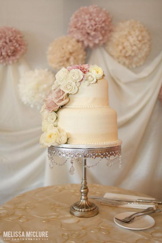 Blush and white wedding cake. Photo by Melissa McClure Photography